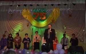 С поздравлениями на сцене - заместитель Председателя Ельского районного исполнительного комитета